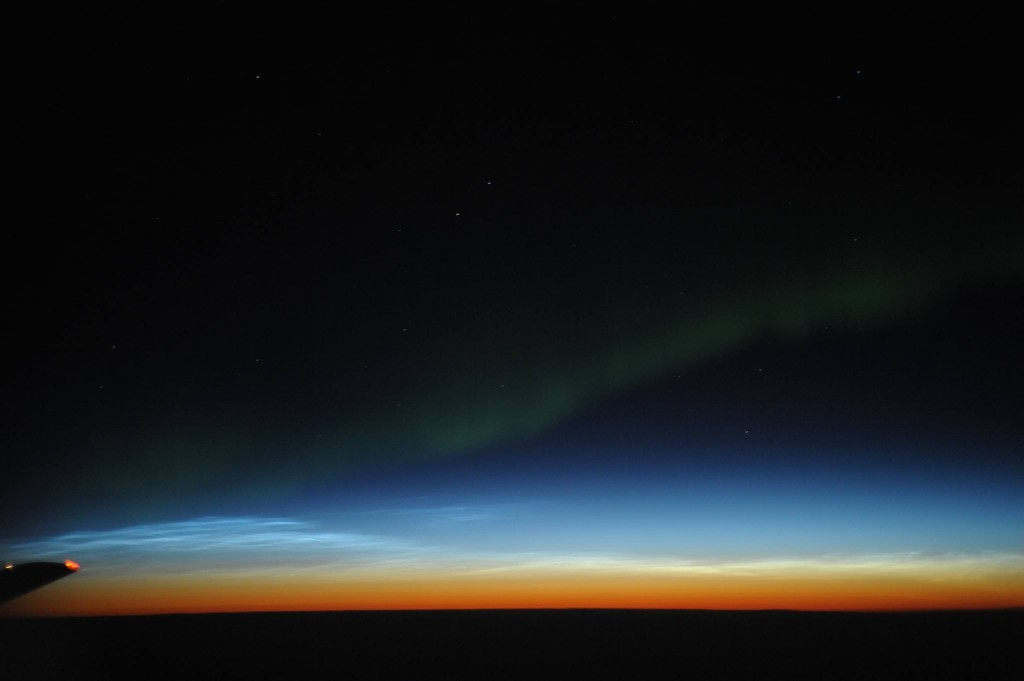 Noctilucent clouds and the Aurora Borealis over western Canada (Joseph A Shaw)
